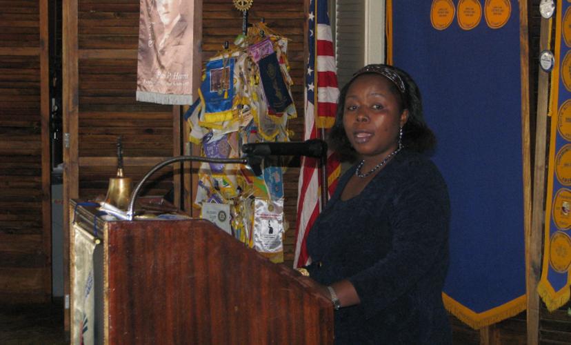 Nabintu speaking at a Rotary Club meeting